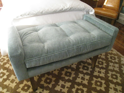 Close up of Tiffany blue velvet bench in a guest bedroom in the Greystone Mansion