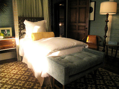 Custom Tiffany blue velvet tufted benches sit at the end of each twin bed in a guest bedroom in the Greystone Mansion