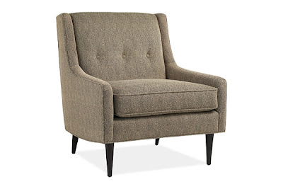 Dark grey upholstered armchair with three button back from Room & Board