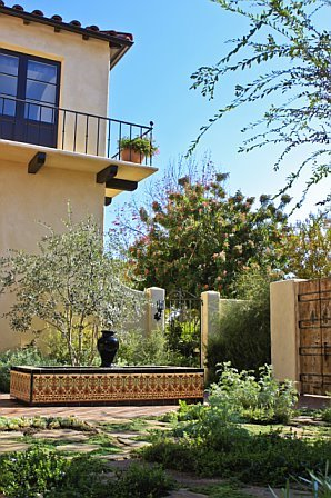 Courtyard in a Cheviot Hills home after remodeling with a tiled fountain
