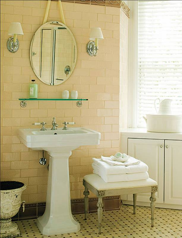 Black And White Tile Bathroom. A white pedestal sink is
