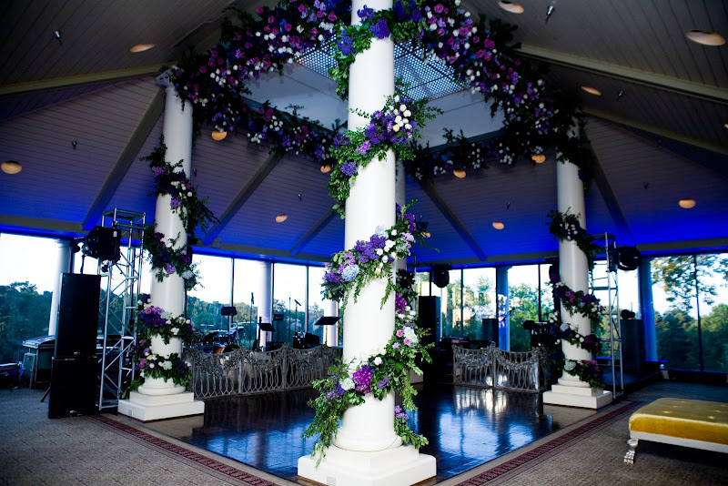 Wedding reception dance floor is flanked by four white classic columns
