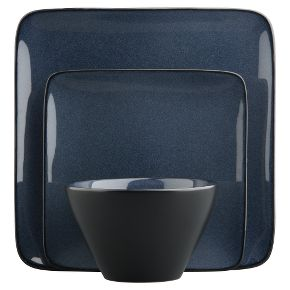 Deep indigo blue stoneware dishes with reactive glaze and matte black exteriors from cb2