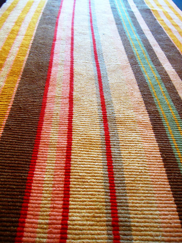 Striped rug in a gallery kitchen