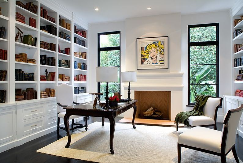 home office in a spanish revival home with white built in bookshelf