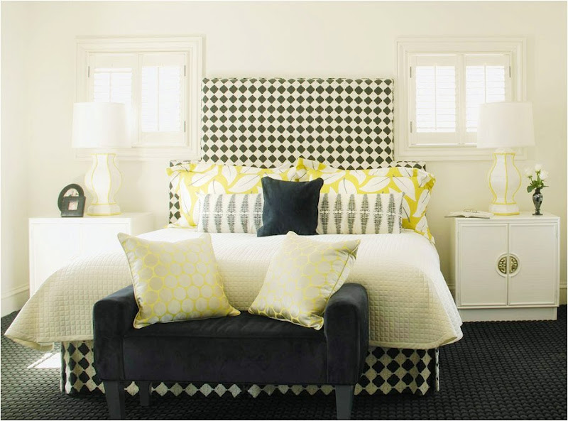  Master bedroom with black and white harlequin patterned upholstered bed and yellow accents