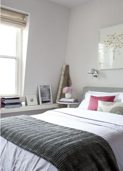simple and serene bedroom is painted in a grey from farrow and ball