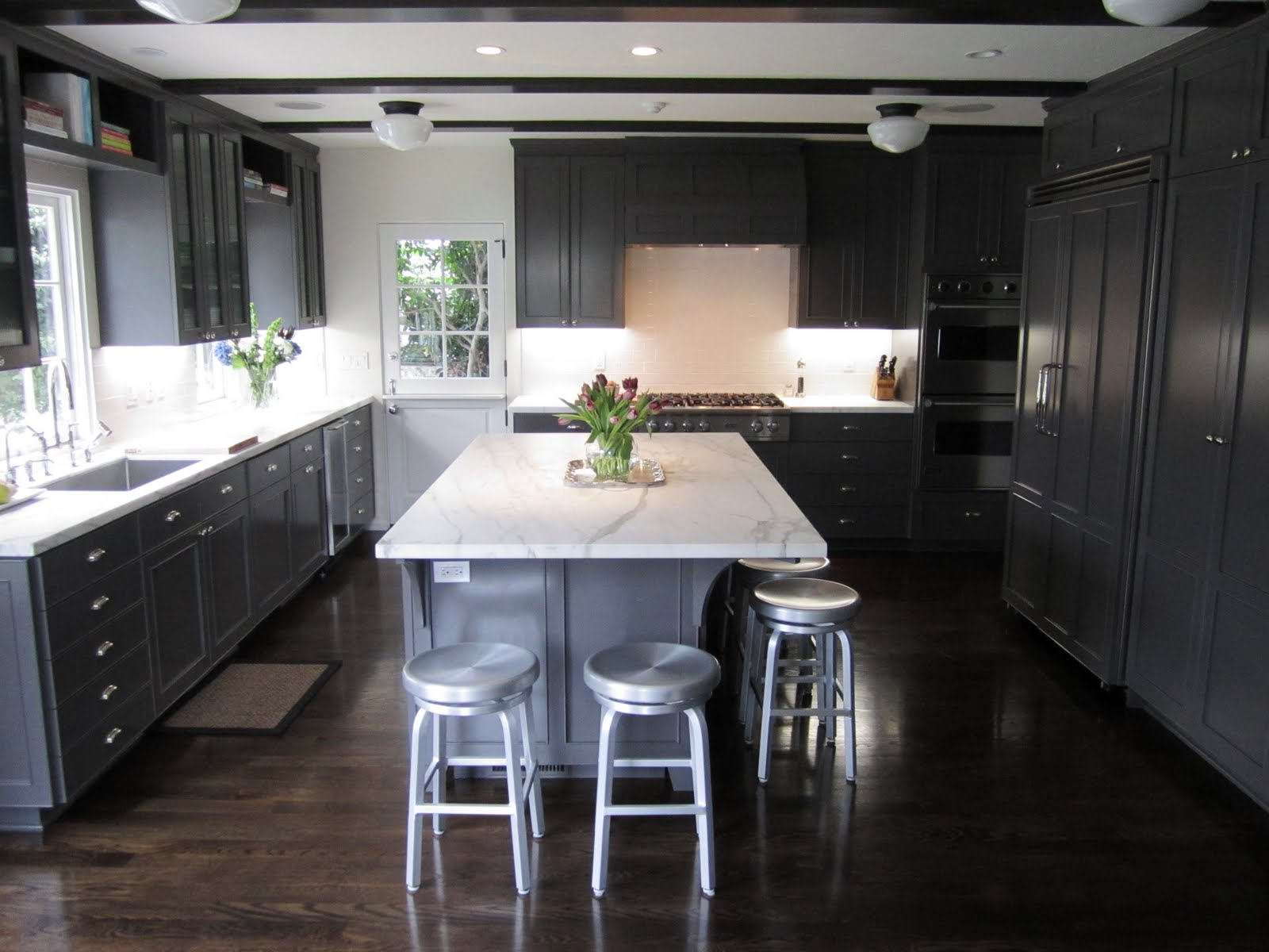 Gray Kitchen Cabinets with Dark Wood Floors