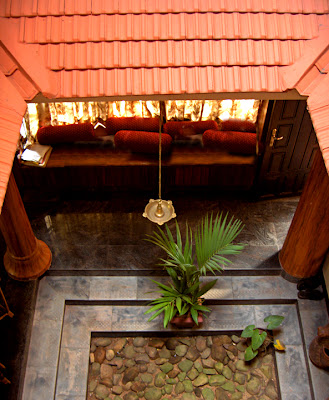 Artnlight a fusion home in kerala for Kerala traditional house plans with courtyard