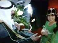 King Abdullah bin Abdul Aziz Al Saud was greeted by a girl wearing a flag dress designed by Baboona