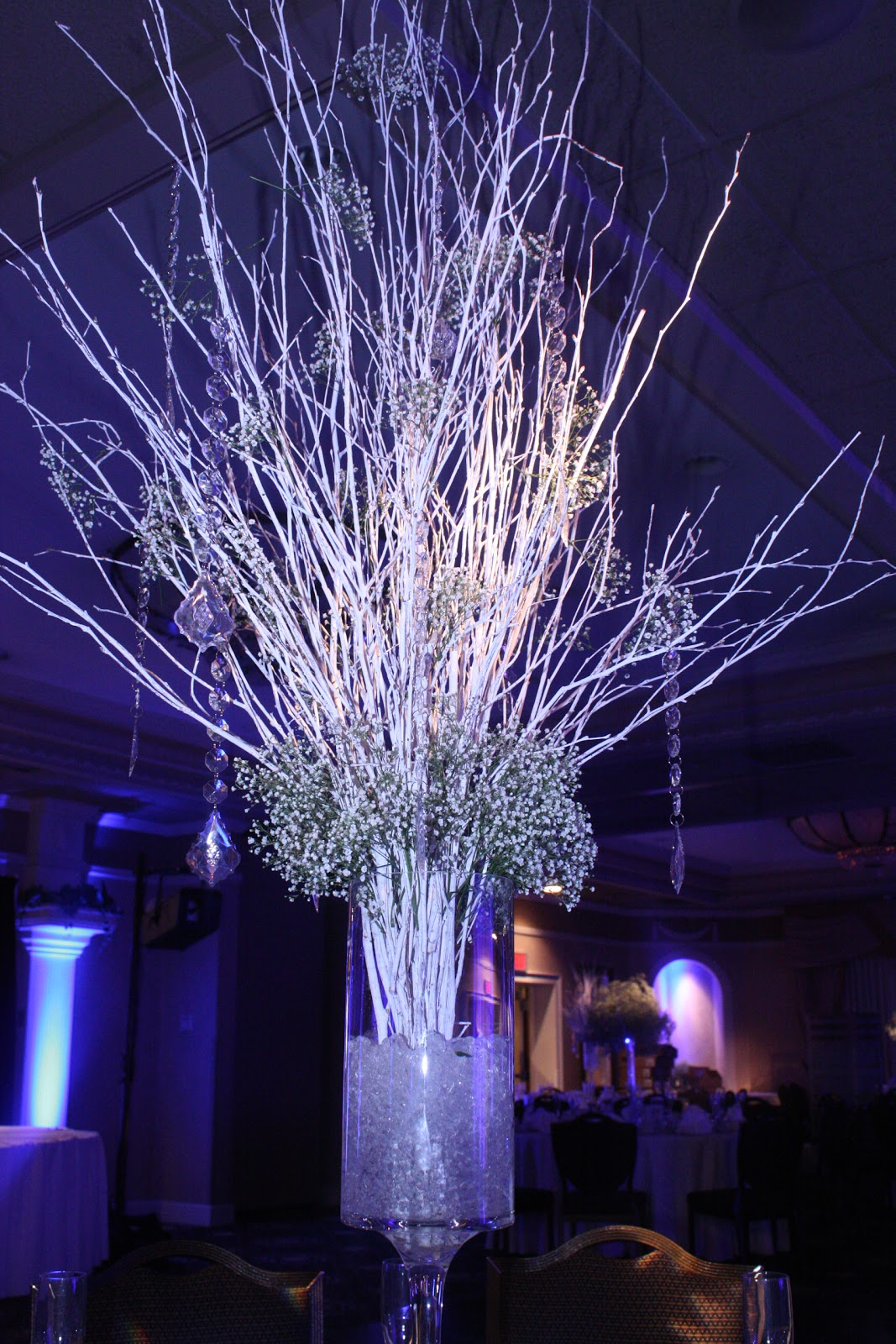 All things beautiful a white christmas wedding reception White christmas centerpieces