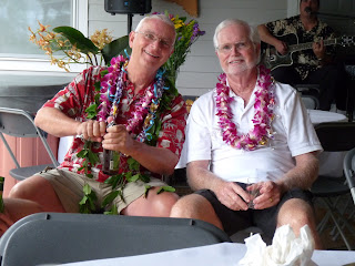 Keoki and his friend Mike with orchid flower leis they got for their birthday