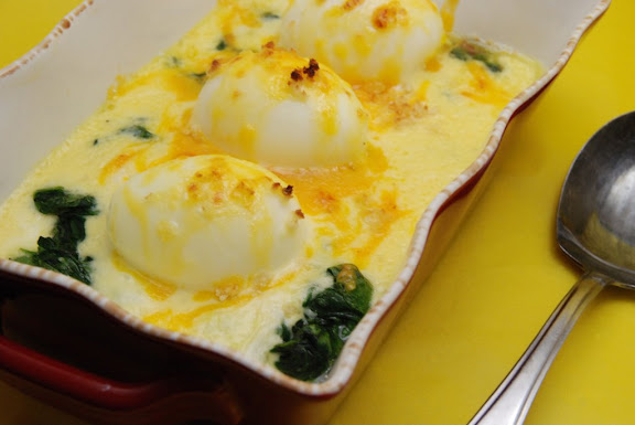 Oeufs Mollets Florentine (Soft-boiled Eggs with Spinach and Mornay Sauce)