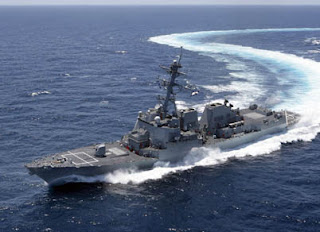 US Navy destroyer USS Gravely in blue ocean