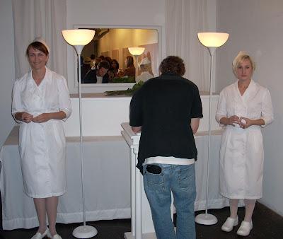 Nurses guarding casket