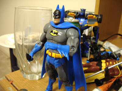 Batman, doing SOMETHING.