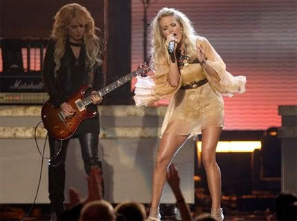 Orianthi Panagaris performing with Carrie Underwood
