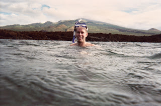 Noah in the Aquarium with the dormant volcano of Haleakalā behind