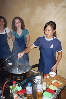 Showing us how to cook with a Wok