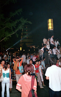 Crowds around the fountains of the Giant Goose Pagoda