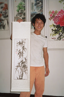 Leo holding the painting I bought