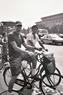 Waiting at a busy Beijing intersection