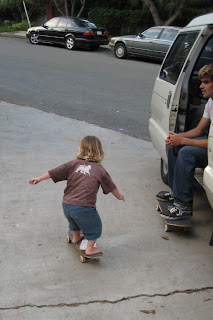 Emery skateboarding past Justin