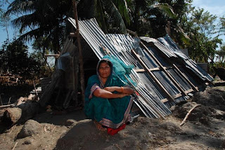 Majeda Begum and the shelter fashioned from materials from her wind-damaged house, Chari Para, Kalapara. Photo – Amin Drik/Concern, Nov 07