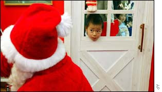 Taishu Mogi, age 6, looks into the office of Santa Claus at a Tokyo department storeSome