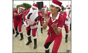 Peruvian traffic police, dressed like elves and Papa Noel, or Santa Claus
