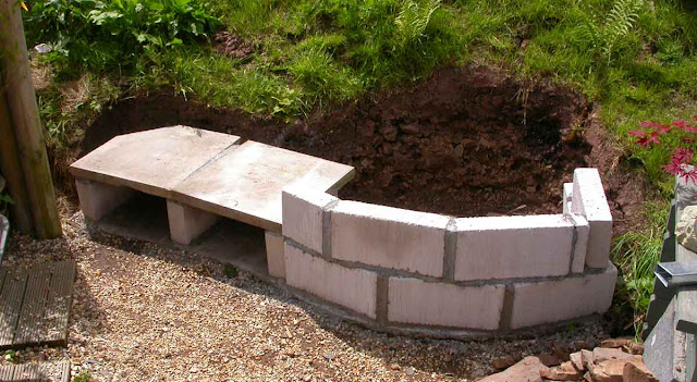 Breeze block wall for oven base and two-slab bench.