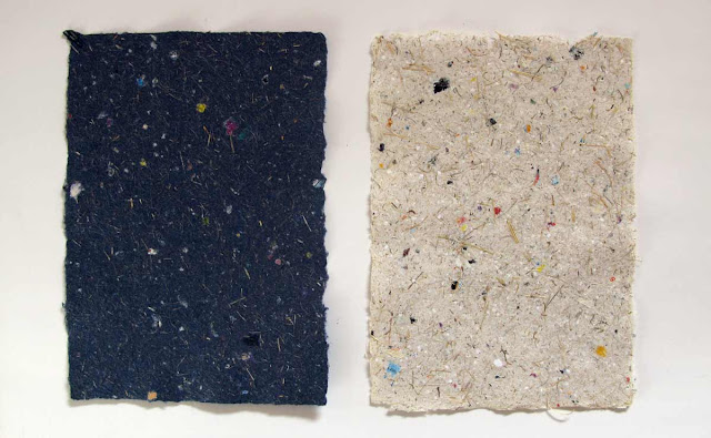 Handmade paper with various bits of paper, grass, reed, etc.