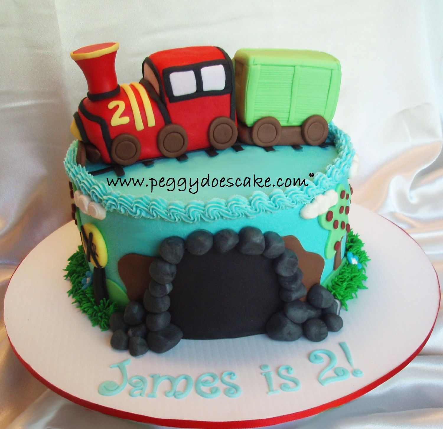 Peggy does cake james turned 2 with a choo choo cake click almond sour cream torted and filled with whipped vanilla bean buttercream everything on the cake is completely edible happy birthday little james thecheapjerseys Images