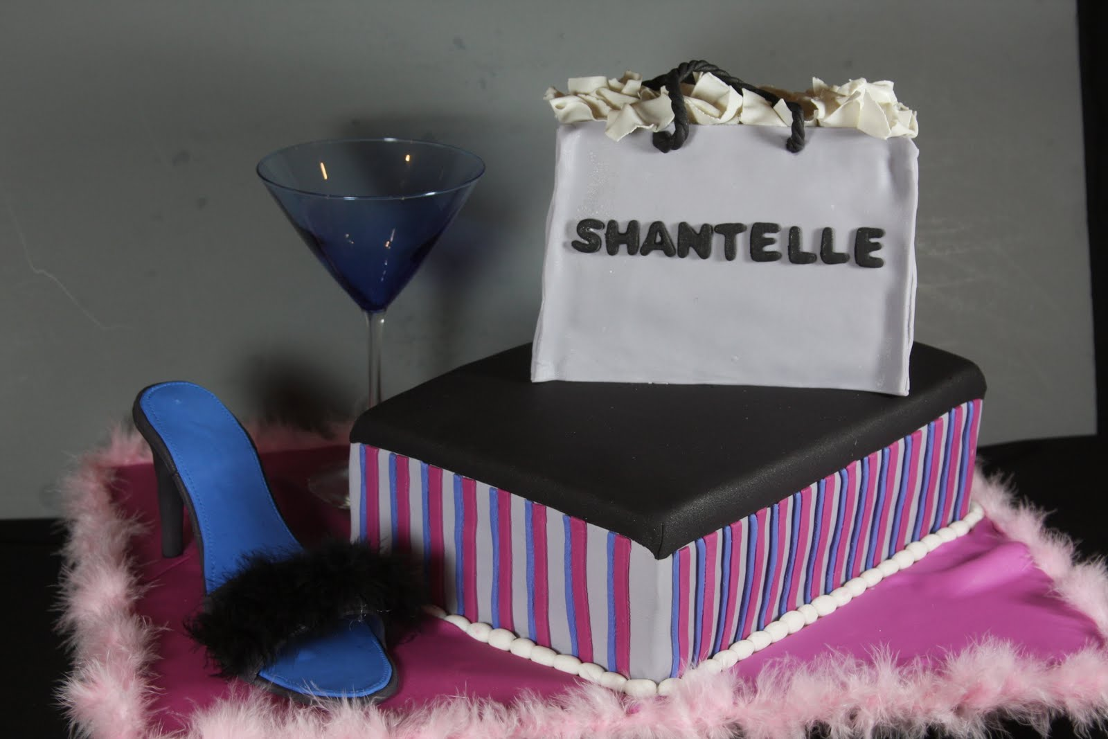 showcasing shantelles bridal shower cake in sex and the city theme