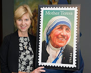 Standing with the unveiled Mother Teresa stamp!