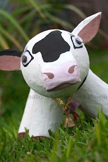 Paper-mache cow. Front view