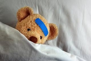 shy teddybear in bed