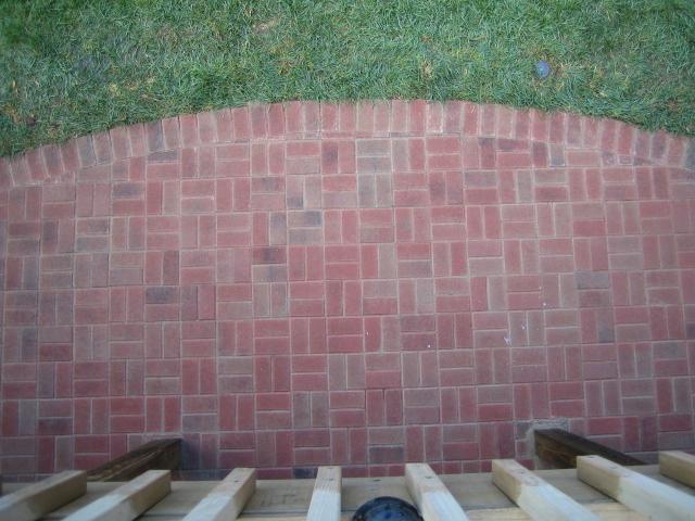 Cement Bead Versus Plastic Edge Restraint For Brick Pavers