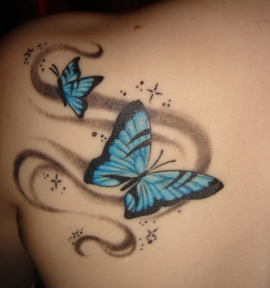 butterfly tattoo, lower back. butterflytattoo-tattoo.blogspot.com