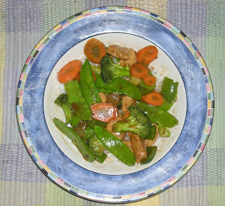 Chinese food with chicken, broccoli, and snow peas