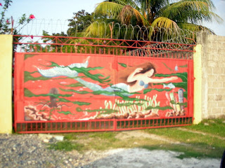 mural on gate, El Porvenir, Honduras