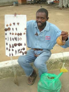 Garifuna selling coconut shell jewelry, La Ceiba, Honduras