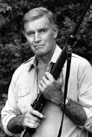 Actor Charles Heston displays one of his rifles at his home in Los Angeles, Calif, in September 1984. Heston, who won the 1959 best actor Oscar as the chariot-racing 'Ben-Hur' and portrayed Moses, Michelangelo, El Cid and other heroic figures in movie epics of the 50s and 60s, died Saturday April 5, 2008 according to a statement from the actor's family. He was 84. AP Photo/Lennox McClendon.