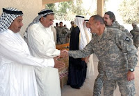 Colonel Dominic Caraccilo, commander of the 3rd BCT, 101st Abn. Div. (AASLT), greets Qarghuli sheikhs prior to a meeting between the tribal leaders and government officials May 3 at Sheikh Mohammed Abdullah's home. (U.S. Army photo by Pvt. Christopher McKenna)