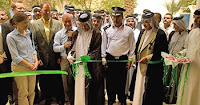 Dignitaries perform a ribbon cutting ceremony at Wasit province's Agricultural Union headquarters in al-Kut, Iraq, June 2. The ceremony marked the grand re-opening of the headquarters. (Photo by Multi-National Division-Central)