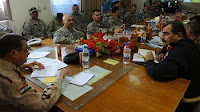 Coaliton officers meet with Iraqi security officials from southern Iraq to discuss boarder enforcement during the Maysan Security Conference held near Amarah, Iraq, Nov. 15.