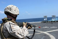 Marine Cpl. Cole Daniels trains with a shotgun aboard the amphibious transport dock ship USS San Antonio. San Antonio is the command ship for Combined Task Force 151. The task force conducts counter-piracy operations in and around the Gulf of Aden, Persian Sea, Indian Ocean and the Red Sea and was established to create a lawful maritime order and develop security in the maritime environment.