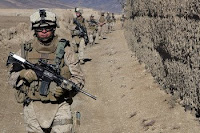 Marines patrol for insurgents in Afghanistan's Helmand province last month. Secretary of Defense Robert Gates has said the military in Afghanistan will focus on concrete, short-term goals.