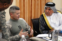 Army Col. Butch Kievenaar, commander of the 4th Infantry Division's 2nd Brigade Combat Team, talks with a sheik from Iraq's Basra province about civil action projects in a June 16 meeting at the Basra Operations Center.