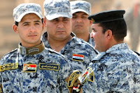 Iraqi national policemen in eastern Baghdad prepare to be responsible for their own security operations as U.S. troops withdraw from Iraq's urban areas.
